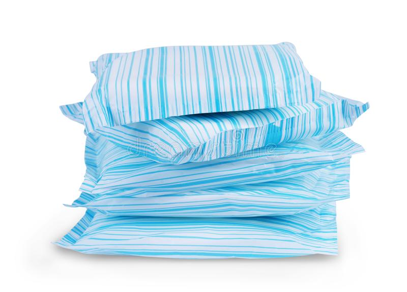 Stack of sanitary napkins, pads on a white background.  royalty free stock images
