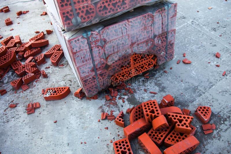 Stack of silicate bricks with the piles of beaten bricks stock image