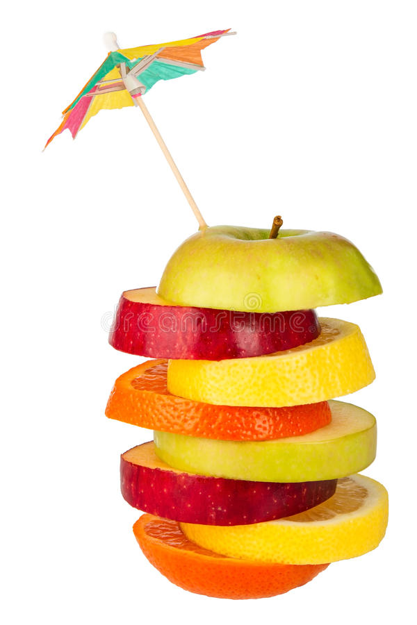 Stack of sliced fruit with straw from above royalty free stock images