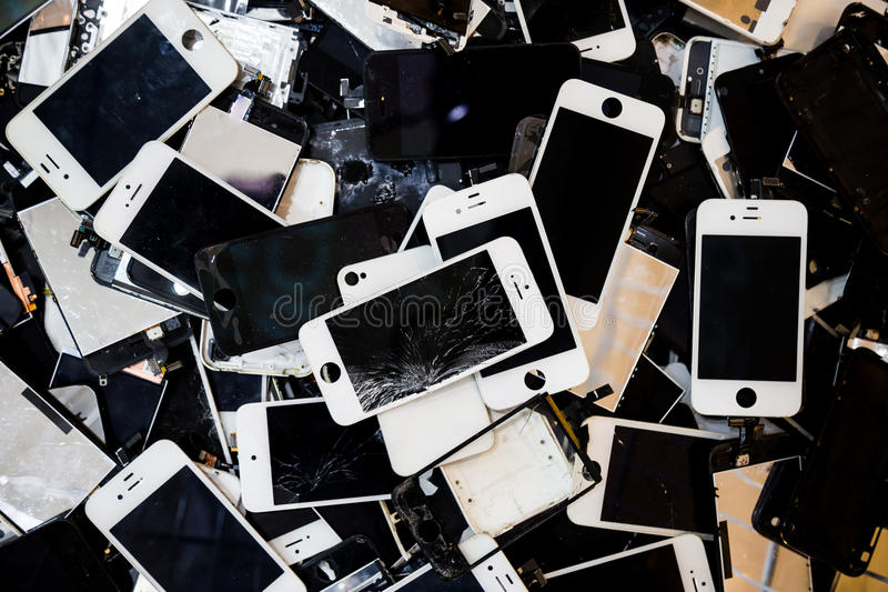Stack of smart phones with cracked and damaged LCD screen.  stock image