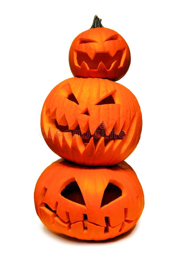 Stack of Halloween Jack o Lanterns isolated on white. Stack of spooky Halloween Jack o Lanterns isolated on a white background royalty free stock photos