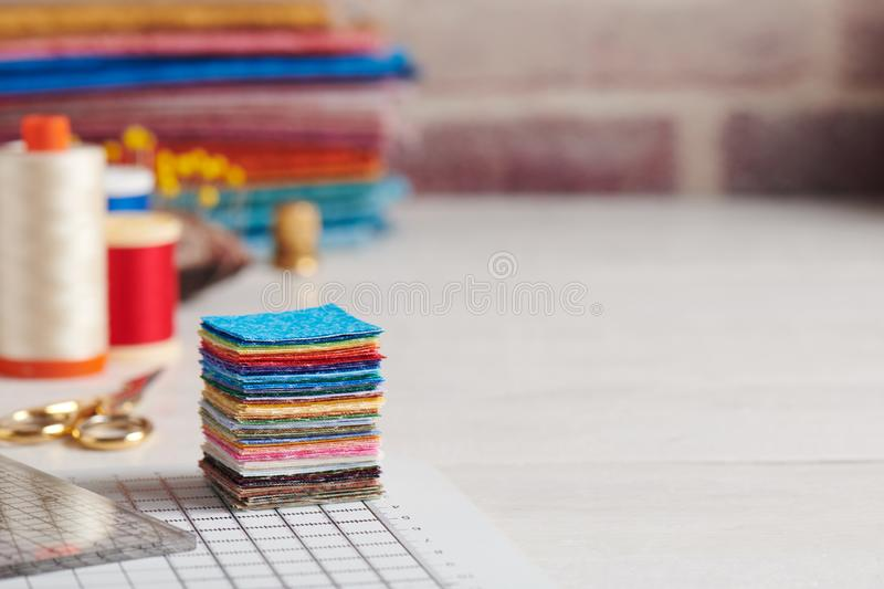 Stack of square pieces of colorful fabrics, accessories for quilting stock photography