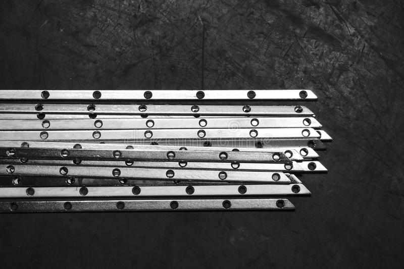 Stack of steel flat bar. Stack of stainless steel flat bar for background used royalty free stock images