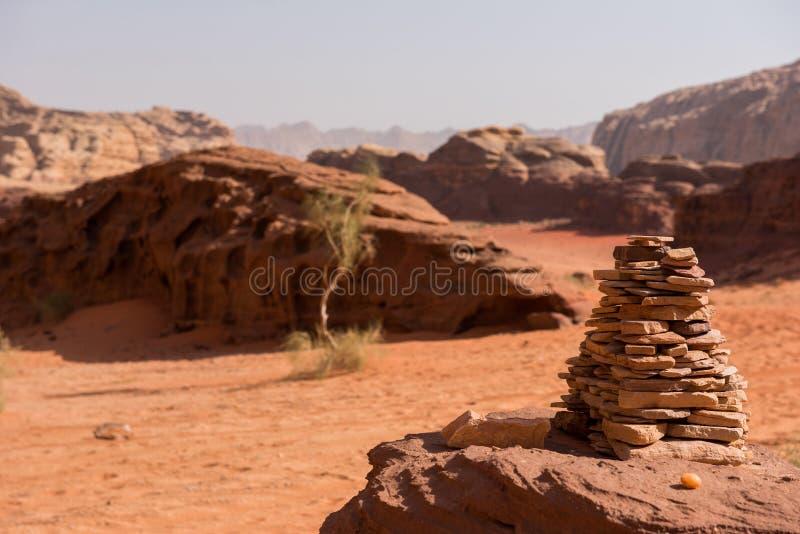 Stack of stones, balanced stone pyramide. In the desert. Wadi Rum, Jordan royalty free stock photos