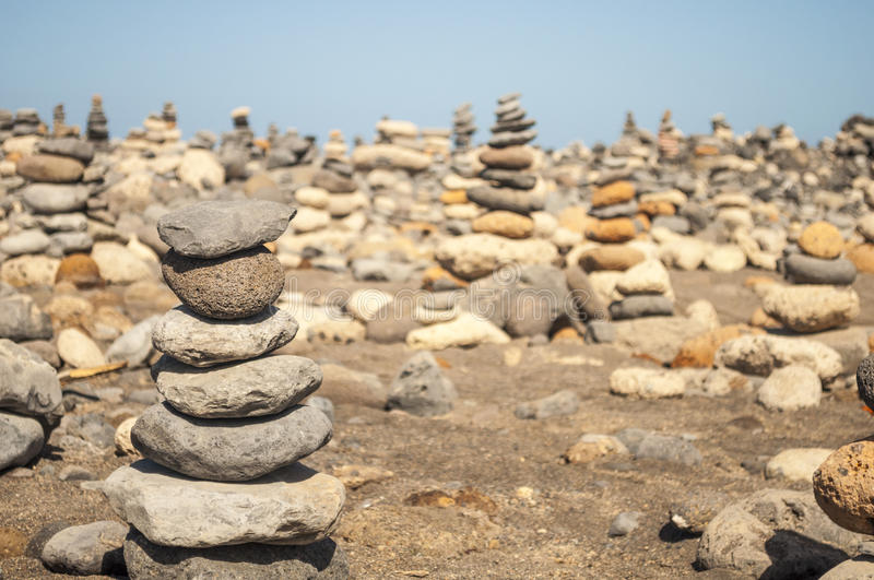 Stack of stones on beach in Tenerife island. Canary Spain stock photography