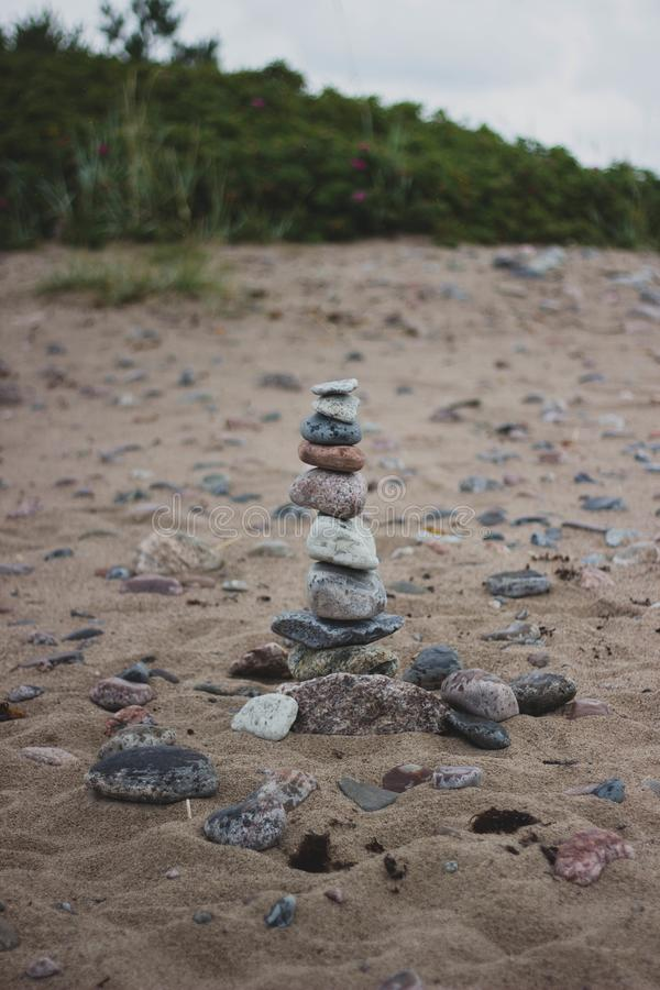 Stack of Stones on the Middle of Brown Soil stock photography
