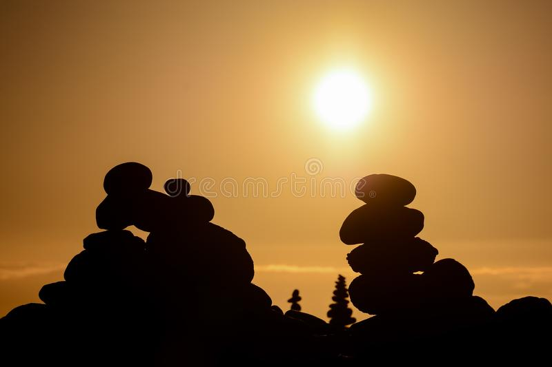 Stack of stones on the sea beach. Photo Picture Stack of stones on the sea beach stock photos