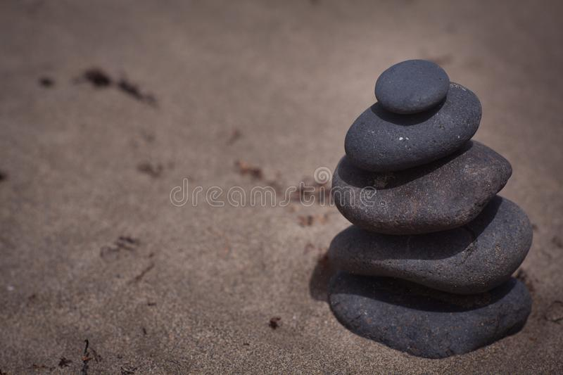 Stack of stones. Balanced on the beach royalty free stock images