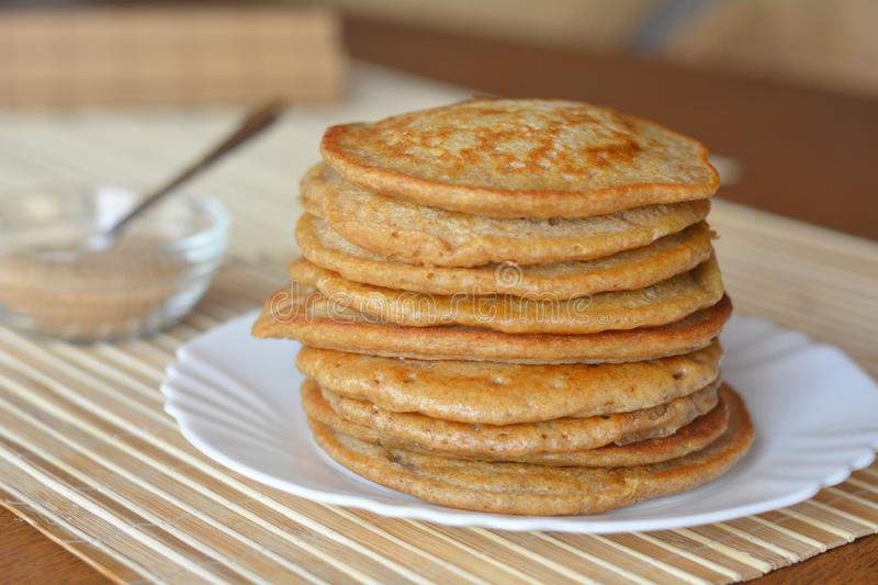 Stack of sweet pancakes with cinnamon sugar stock image