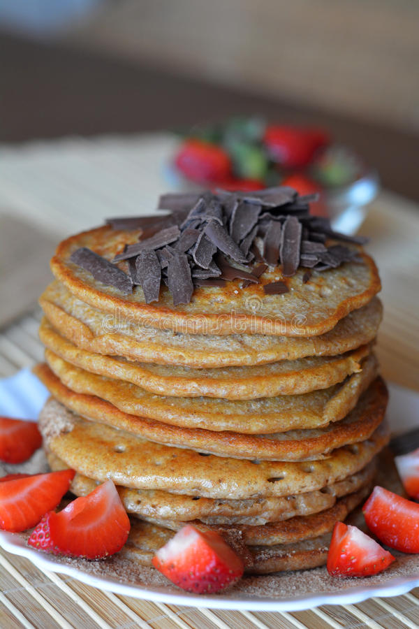 Stack of sweet pancakes with strawberries and chocolate royalty free stock photography