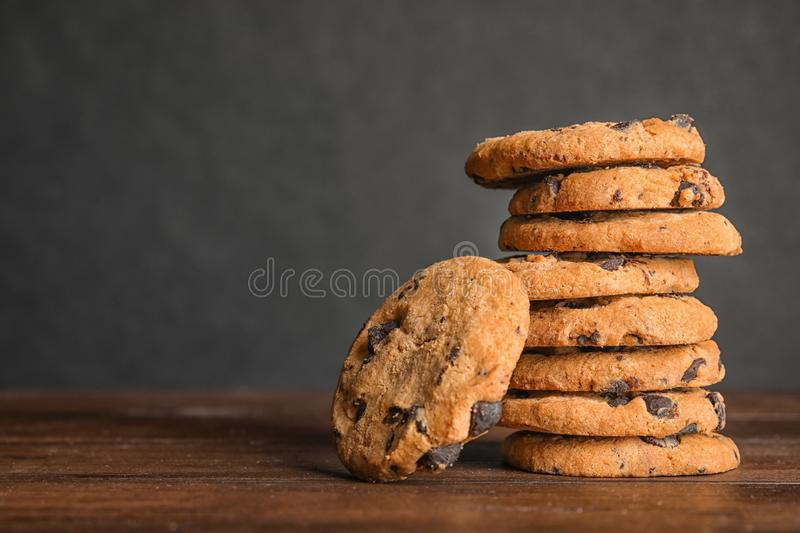 Stack of tasty chocolate chip cookies on wooden table. Space for text royalty free stock photos