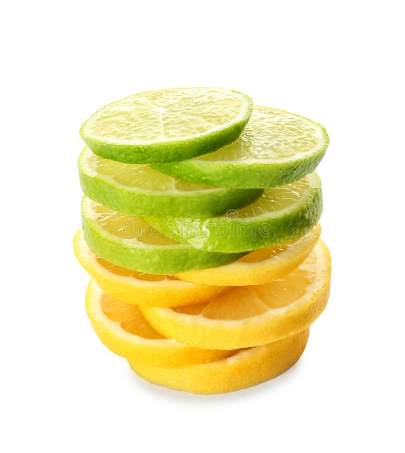 Stack of tasty lime and lemon slices on white background royalty free stock images