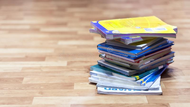 Stack of Textbooks on Wooden Floor. Education, School Holidays, Back to School Concept. Copy Space stock images