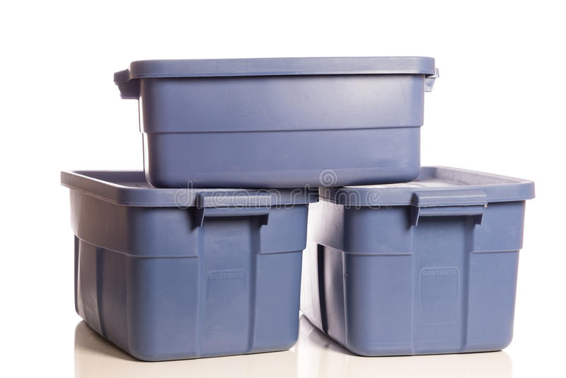 Stack of three blue storage tubs royalty free stock image