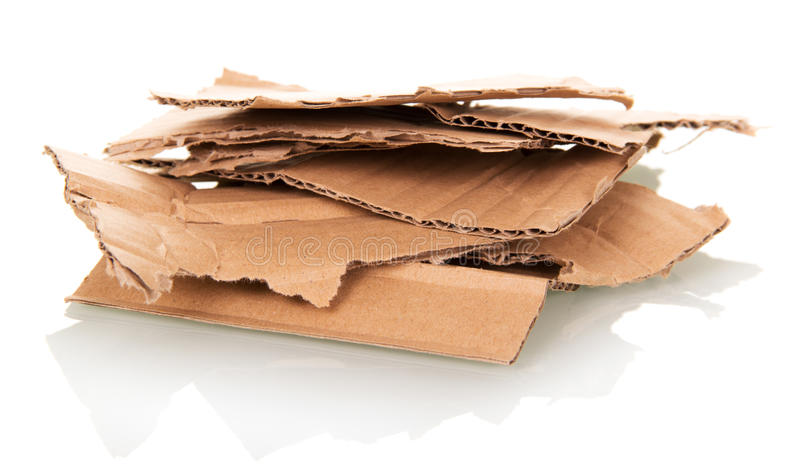 Stack of torn cardboard isolated on white background royalty free stock photo