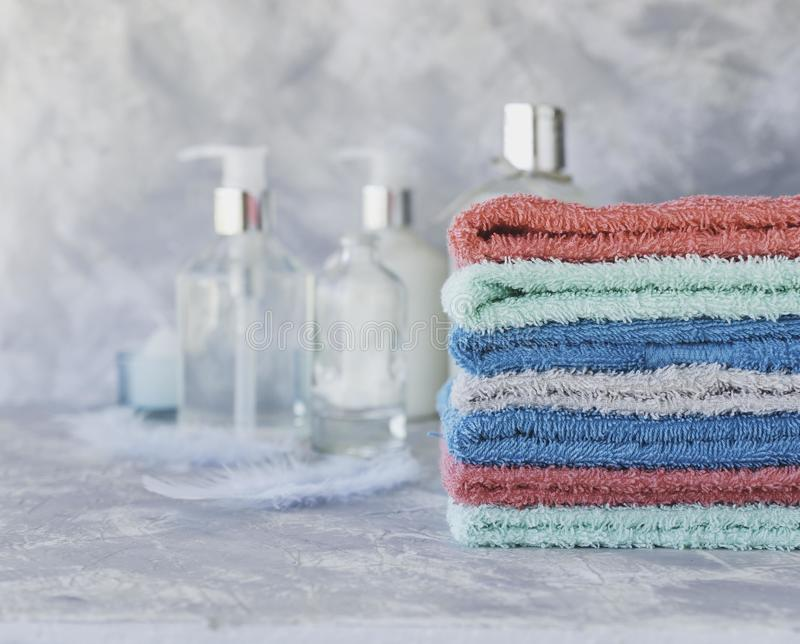 Stack of towels for bathroom bottles on a white marble background, space for text, selective focus stock images