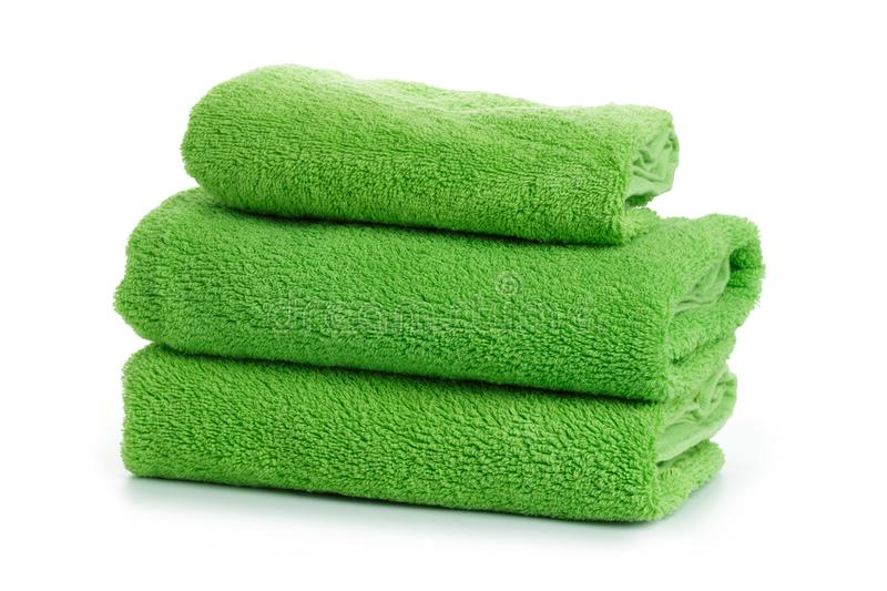 A stack of towels green on a white background isolation royalty free stock photography