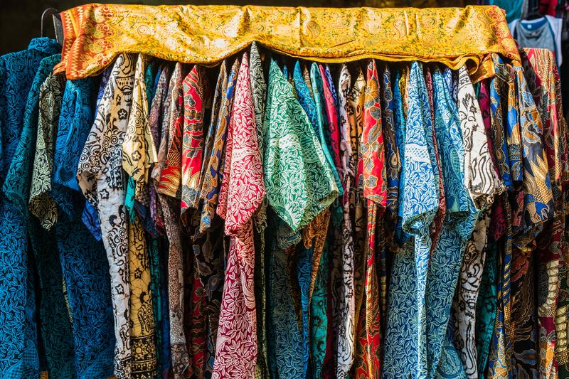 Stack of traditional colourful sarong in a row on the market in Indonesia royalty free stock images