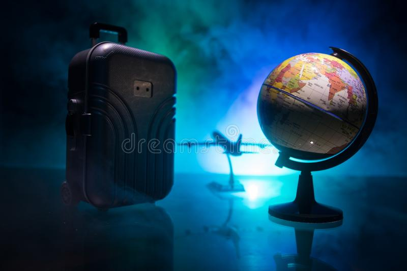 stack of traveling luggage in airport terminal and passenger plane flying over sky royalty free illustration