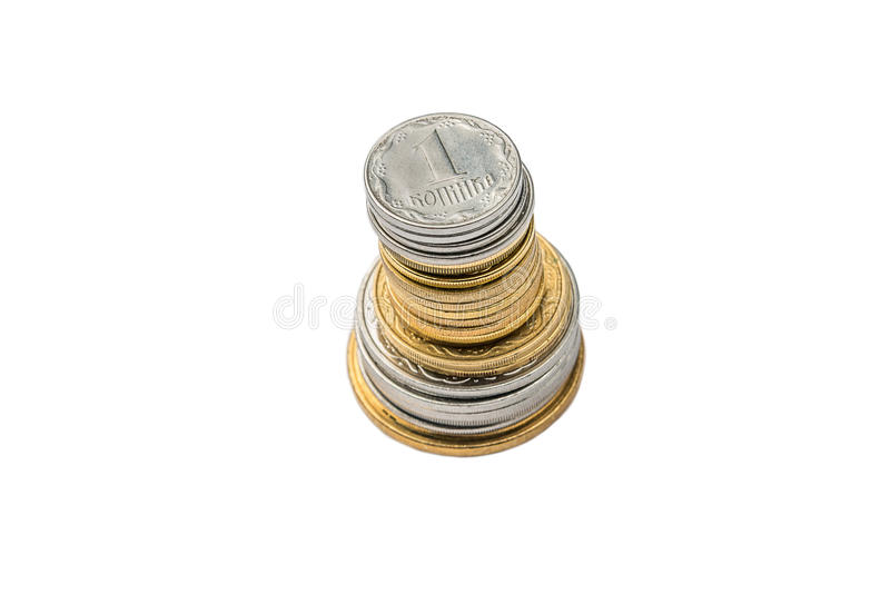 A stack of Ukrainian coins on a white isolated background. Eurovision 2017 in Ukraine. A stack of Ukrainian coins on a white isolated background. Eurovision in royalty free stock photo