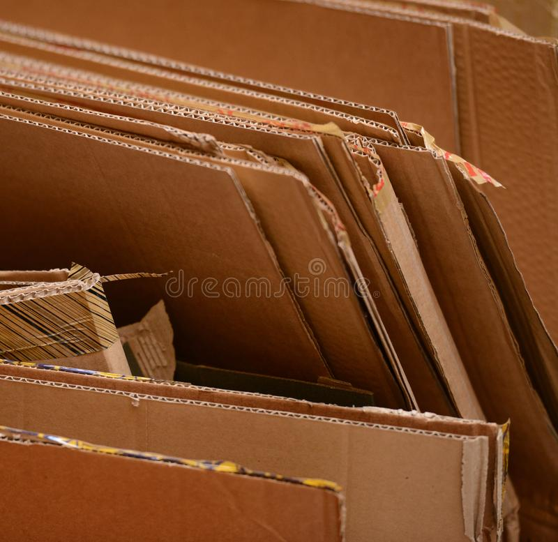 Stack of used cardboard ready for recycling stock photos