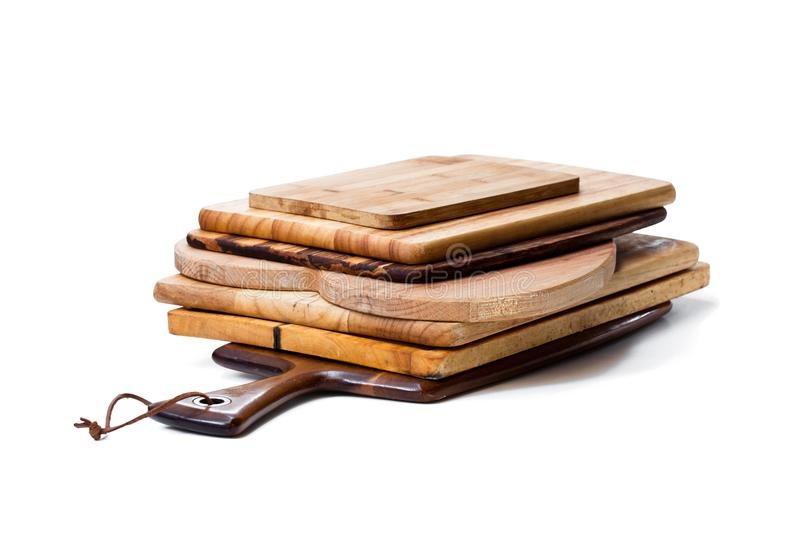 Stack of used cutting boards isolated on white royalty free stock photo