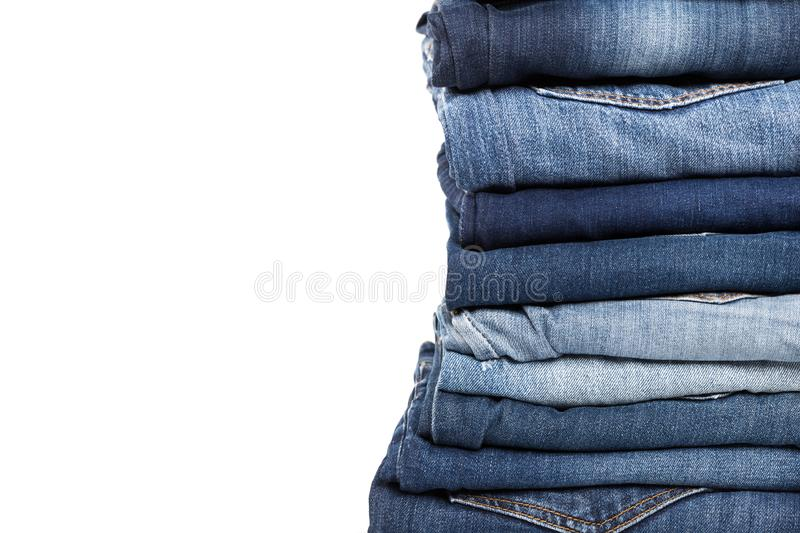 Stack of various shades of blue jeans royalty free stock photography
