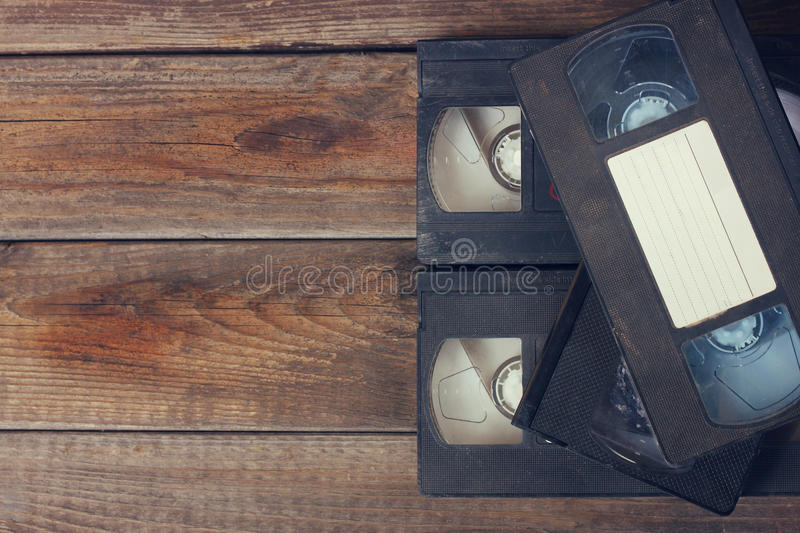 Stack of VHS video tape cassette over wooden background. top view photo royalty free stock photos