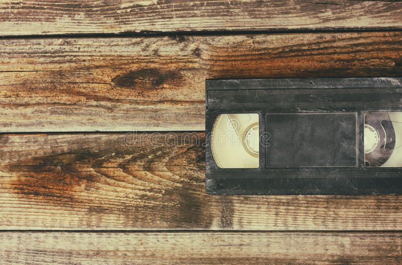 Stack of VHS video tape cassette over wooden background. top view photo.  stock photography