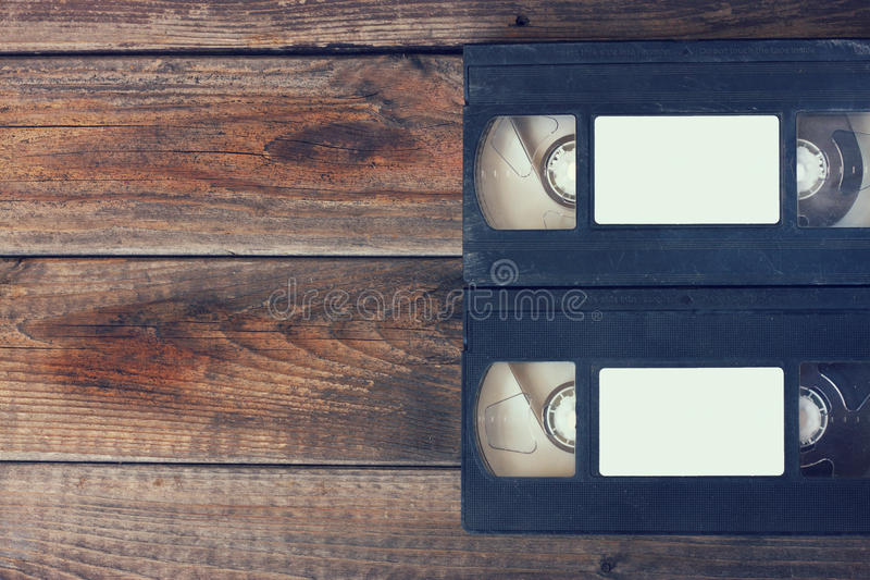 Stack of VHS video tape cassette over wooden background. top view photo. retro style image stock photo