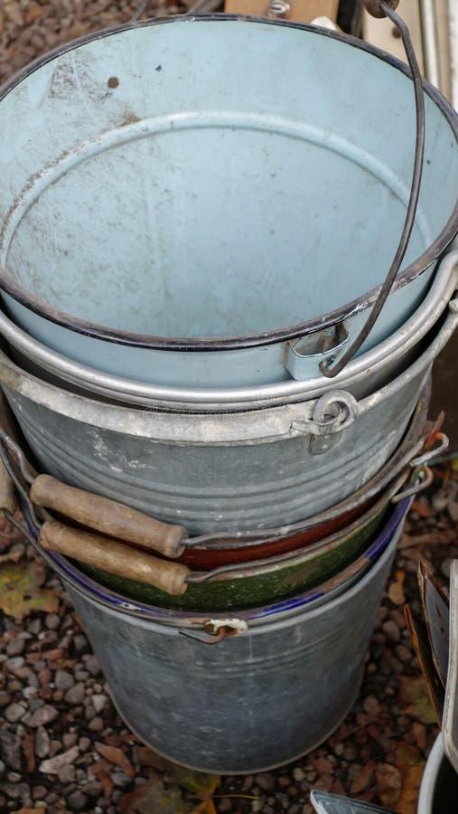 Stack of vintage metal buckets on a flea market in Berlin, Germany stock photos
