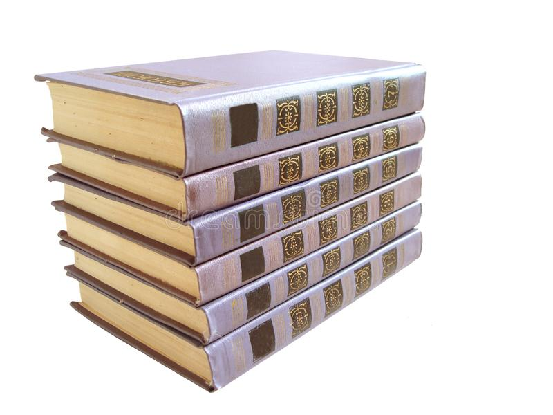 Stack of violet books with numbers over white background