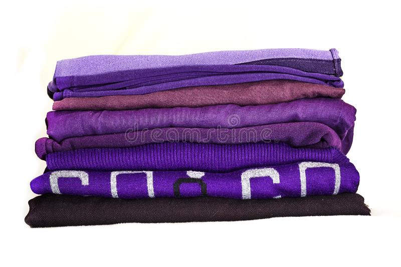 Stack violet winter clothes isolated on white background. royalty free stock photography