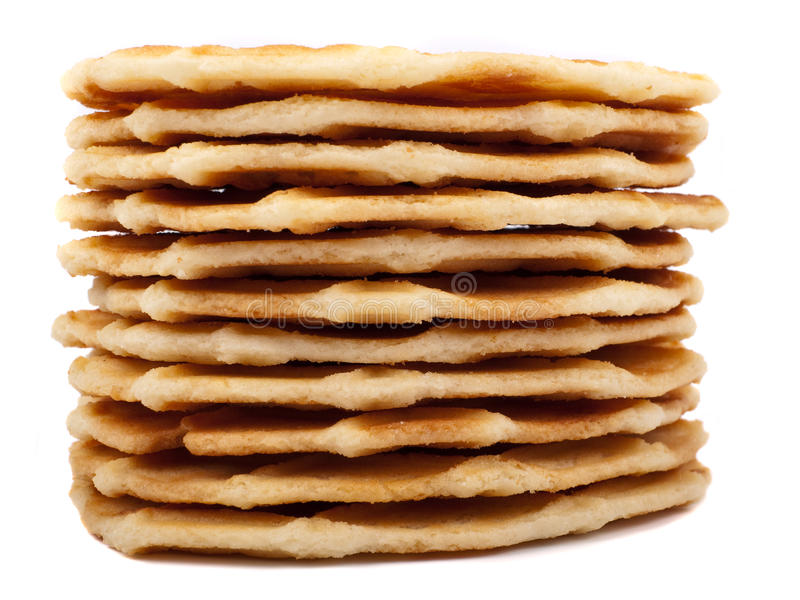 Stack of waffle cookies. Against a white background royalty free stock image