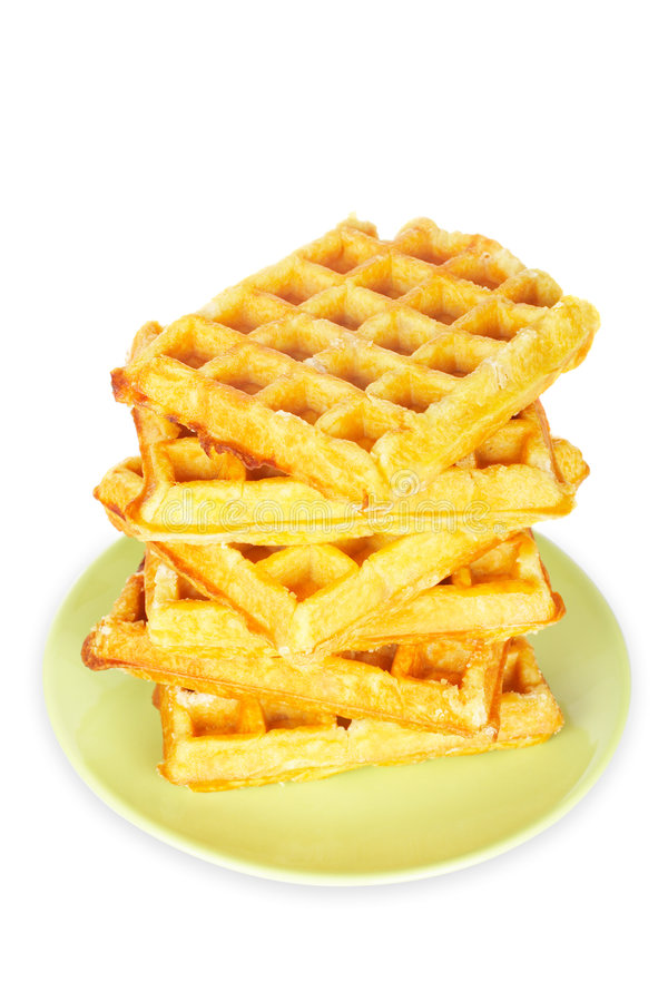 Stack of waffles. A big stack of waffles on the green plate with soft shadow on white background stock images
