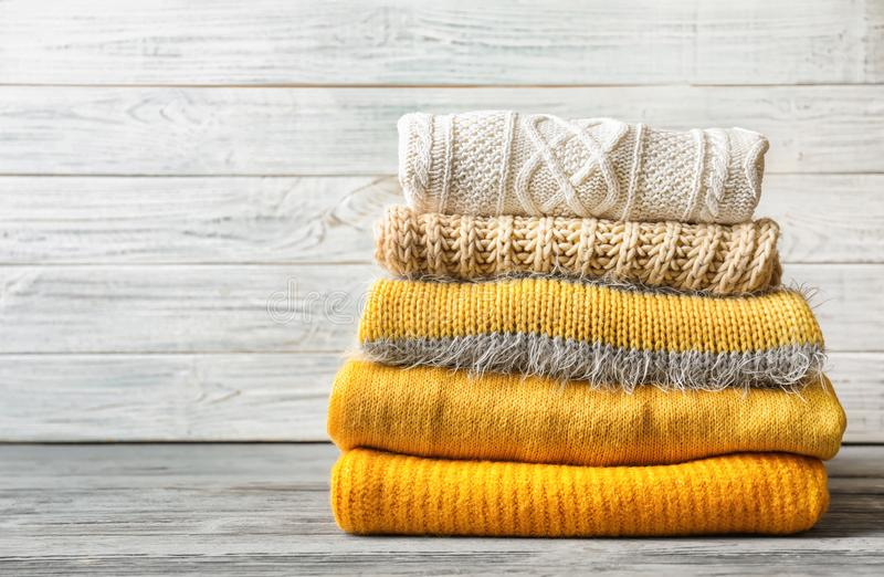 Stack of warm knitted clothes royalty free stock images