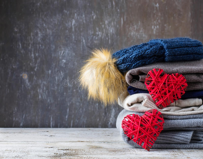 Stack of warm knitted clothes stock photography