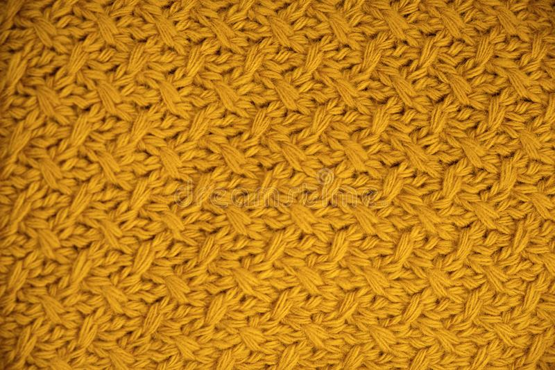 Stack of Warm knitwear close-up. Woolen knit texture as background stock image