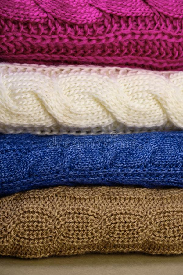 Stack of Warm knitwear close-up. Woolen knit texture as background royalty free stock image