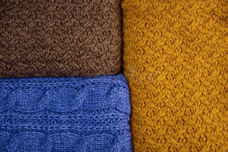 Stack of Warm knitwear close-up. Woolen knit texture as background stock photos