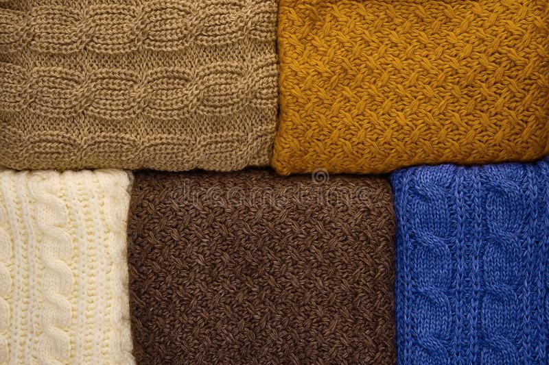 Stack of Warm knitwear close-up. Woolen knit texture as background royalty free stock photo