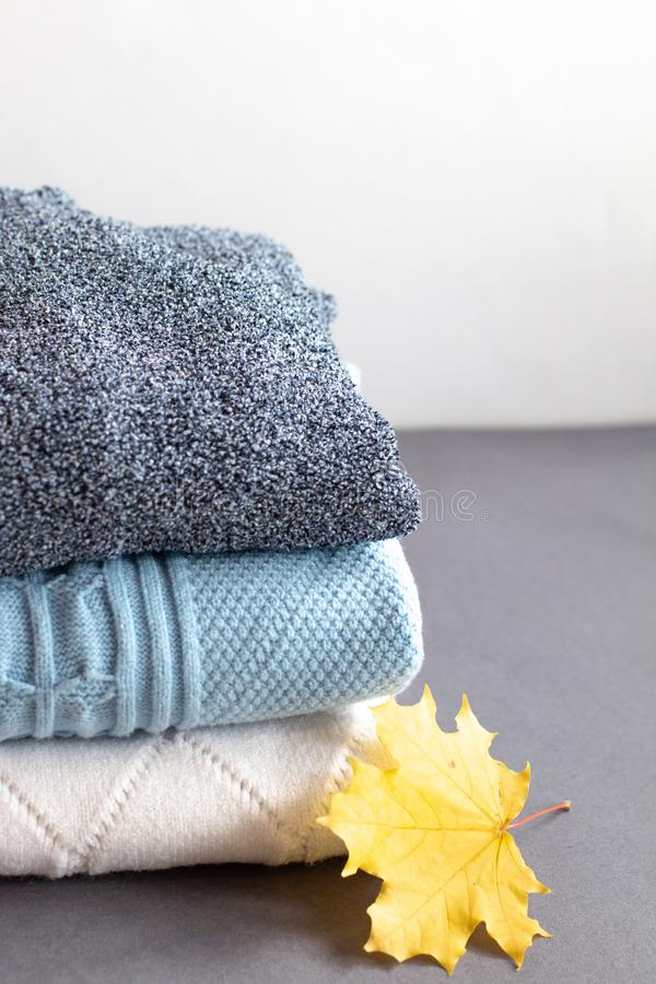 A stack of warm winter sweaters royalty free stock images