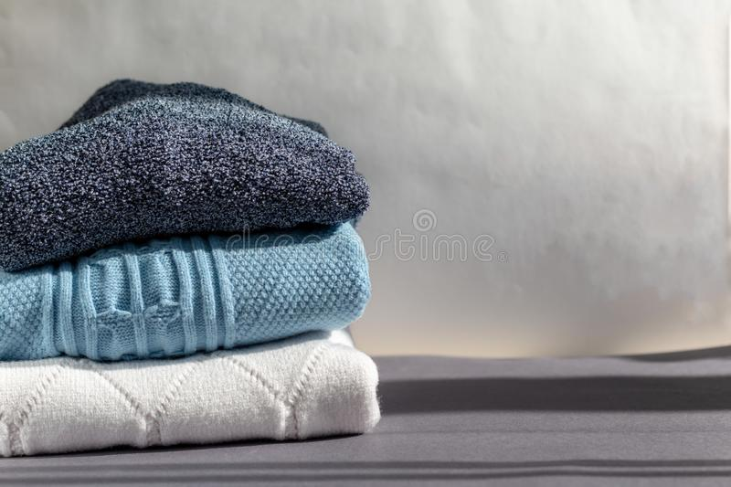 A stack of warm winter sweaters stock image