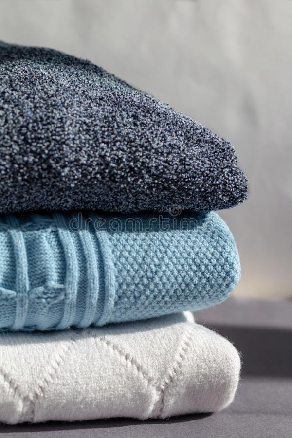 A stack of warm winter sweaters royalty free stock photos