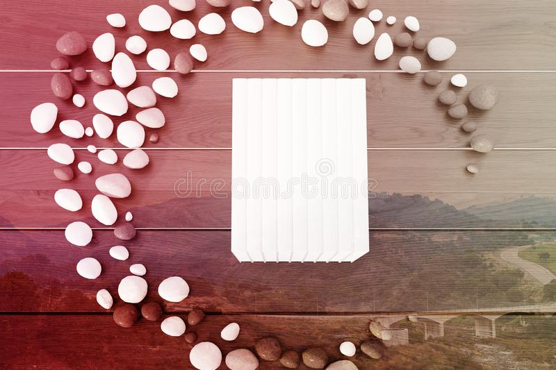 Stack of white books on a gray table double stock illustration