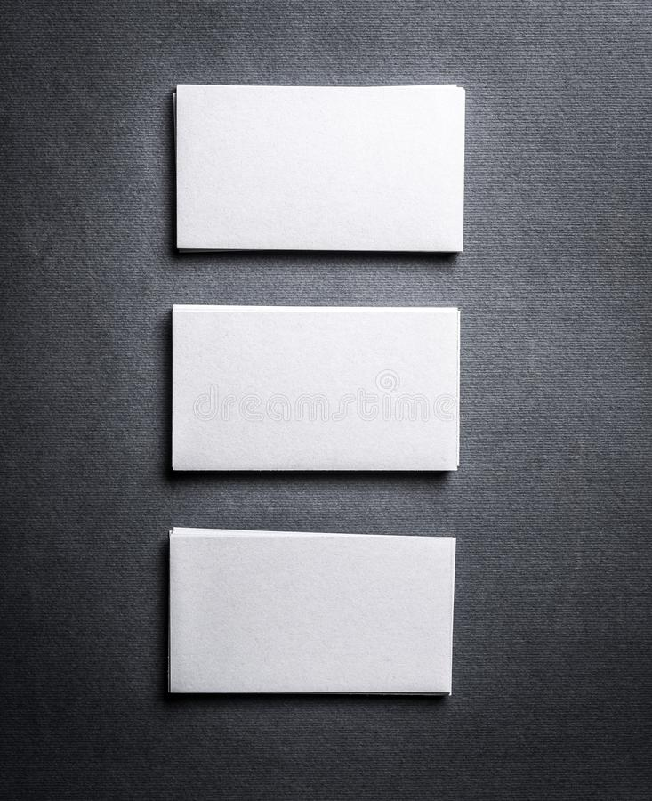 Stack of white business cards with blank space on grey background download stack of white business cards with blank space on grey background stock photo colourmoves