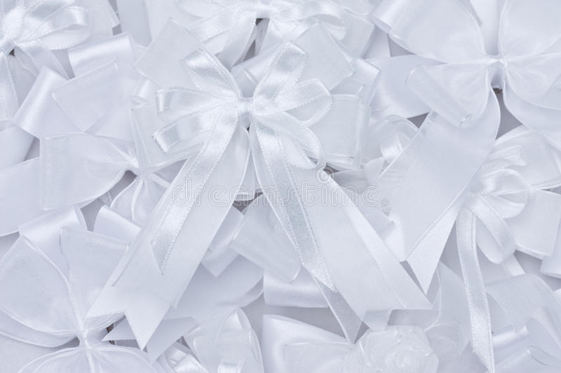 Stack of white fabric bow