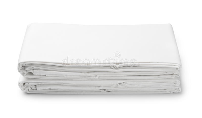 Stack of white folded bedding sheets royalty free stock image