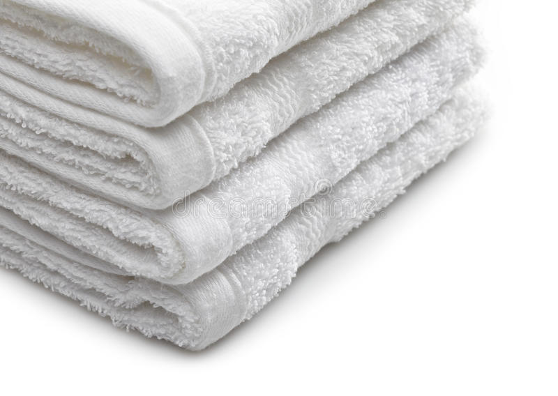 Stack of white hotel towels stock images