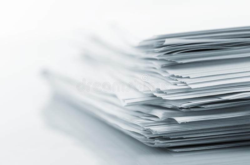 Stack of white papers stock images